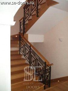 Ограждение лестницы кованые перила